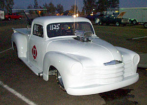 I discovered this plastic pickup in the pits. It's Pro Mod style, with nearly 600ci under that wedged hood. Owner was shaking it down